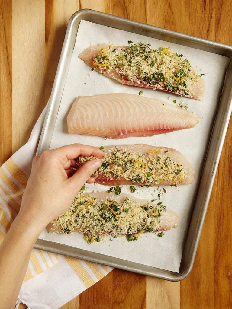 lemon fish fillets on a baking sheet