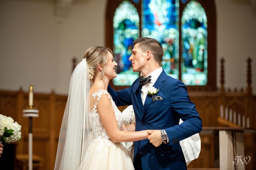 first kiss at St Stephen's captured by Church Calgary wedding photographer Tara Whittaker