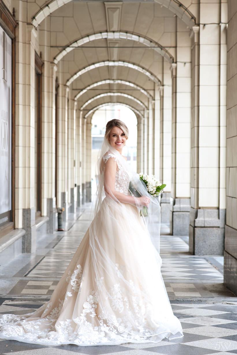 bride at Hudson Bay on Stephen Avenue captured by Calgary wedding photographer Tara Whittaker