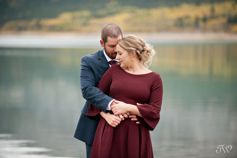 bride and groom during their barrier lake engagement session captured by Tara Whittaker Photography