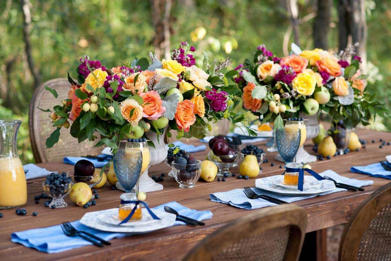 harvest table dressed with flowers and fruit captured by Tara Whittaker Photography