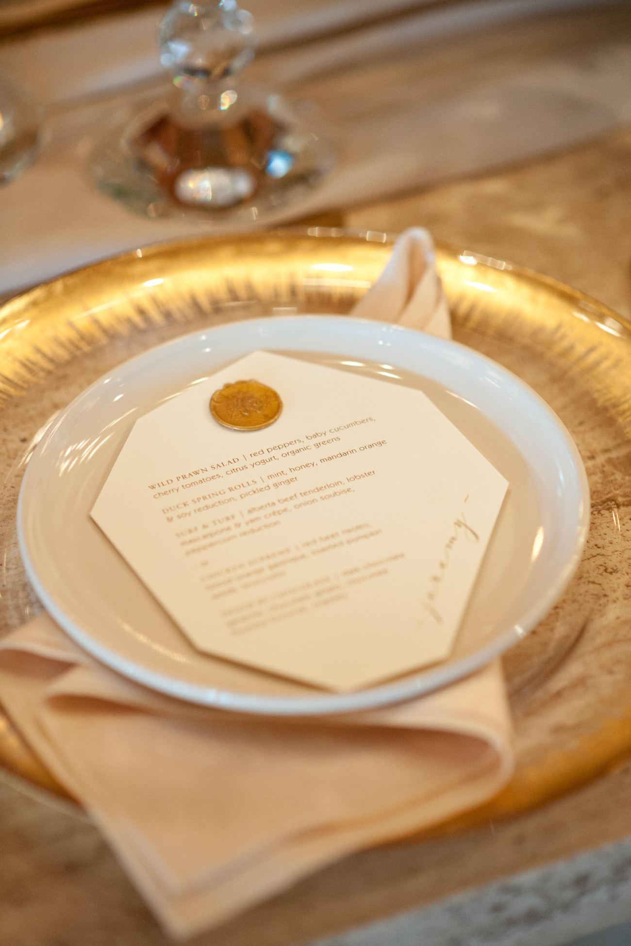 Wedding menu with a wax seal captured by Tara Whittaker Photography