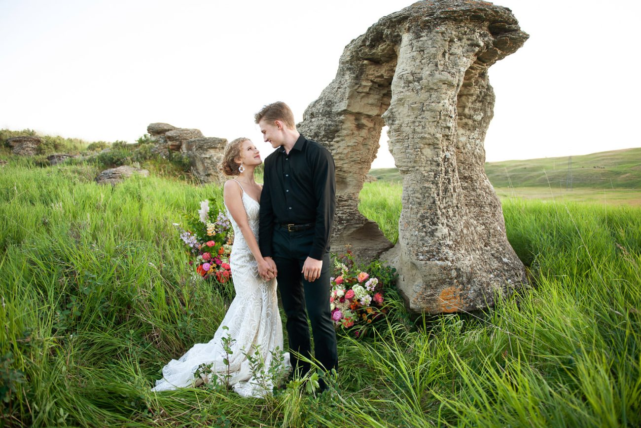 bride and groom pose after their Alberta wedding captured by Tara Whittaker Photography