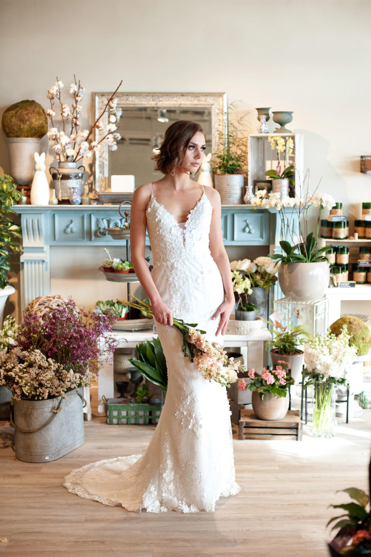 bride wears a floral lace gown from Lis Simon captured by Tara Whittaker Photography