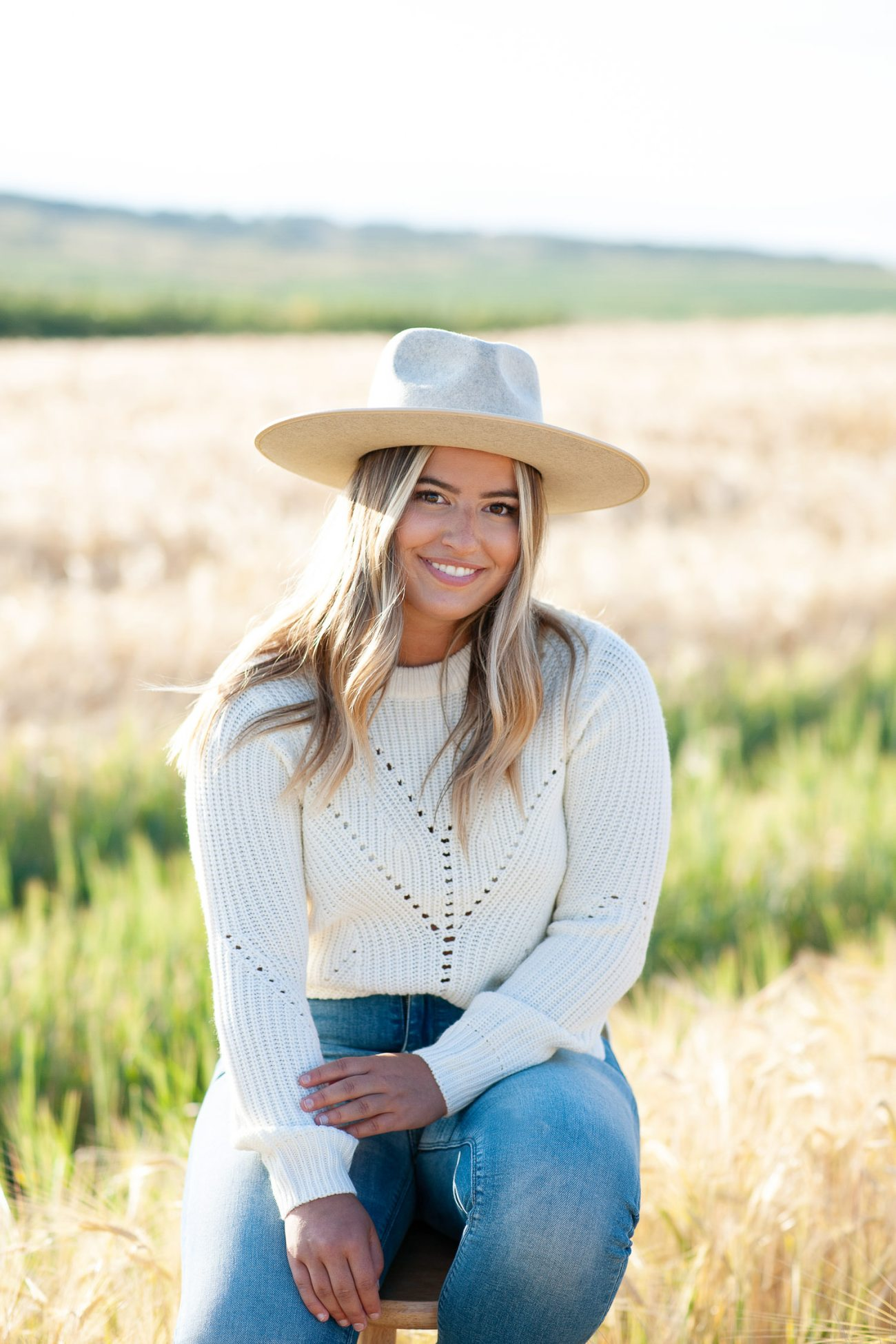 Bride wears a cozy sweater and hat for fall engagement session captured by Tara Whittaker Photography