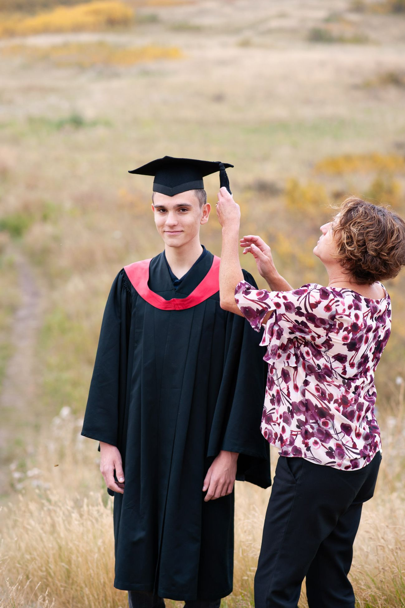 Calgary graduate with his Mom captured by Tara Whittaker Photography