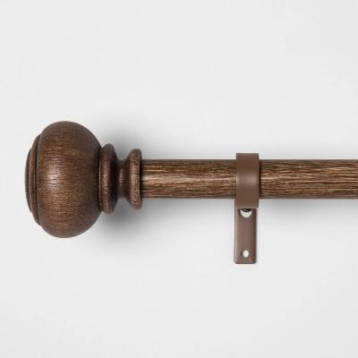 carved light woodtone ball curtain rod