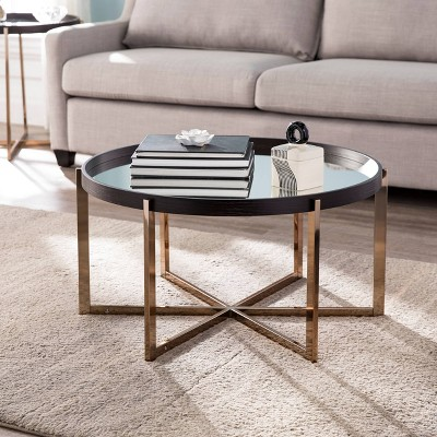 moswick round cocktail table with mirrored top black champagne aiden lane