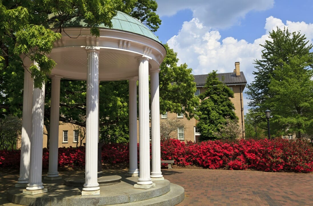 The Old Well at the University of North Carolina at Chapel Hill. Old East residence hall in the background.