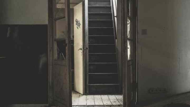 worn out property, with damaged door and stairwell. The owner may be subject to premises liability lawsuits without proper legal protection