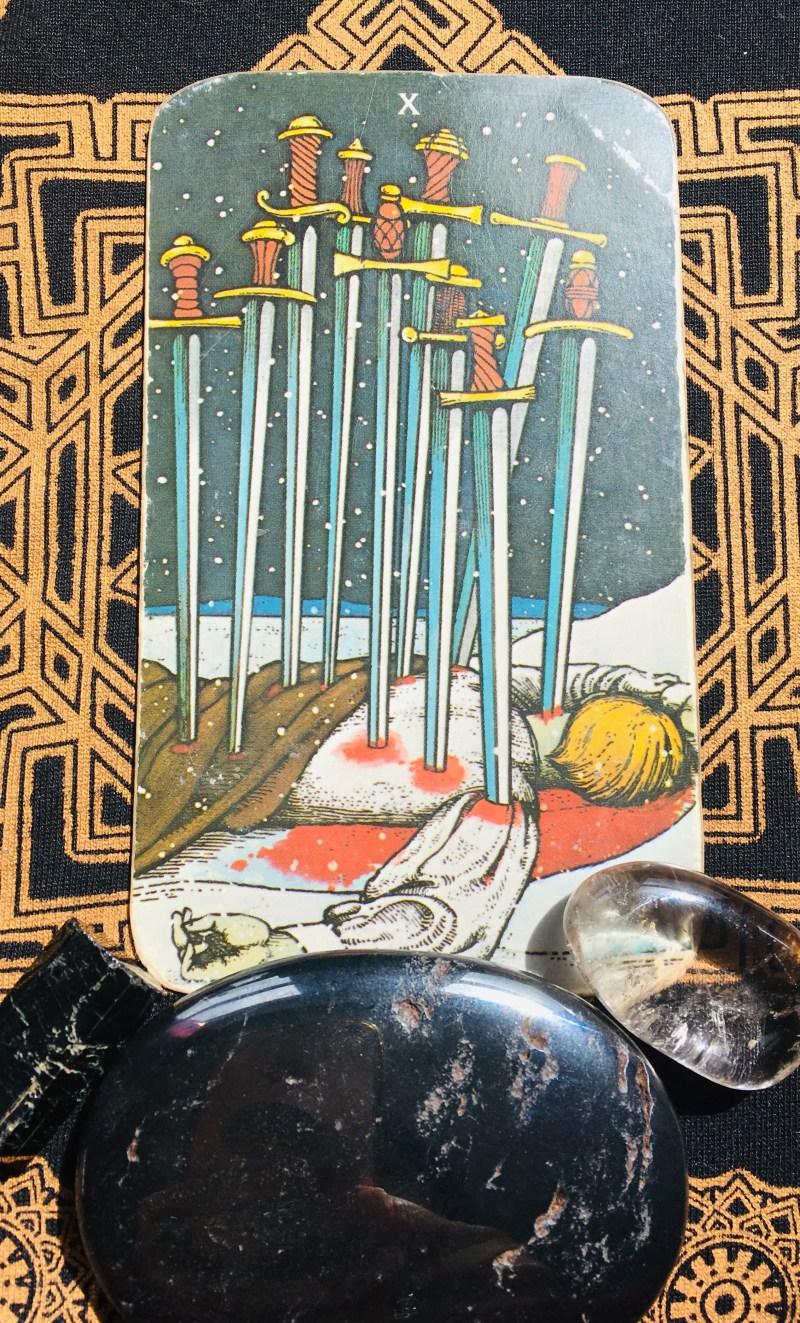 Ten of Swords, end of difficulties.