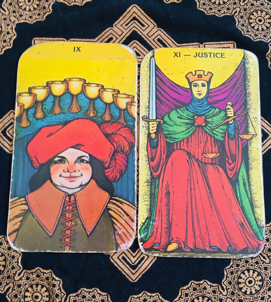 Hard Work. Nine of Cups and Justice Tarot Cards.