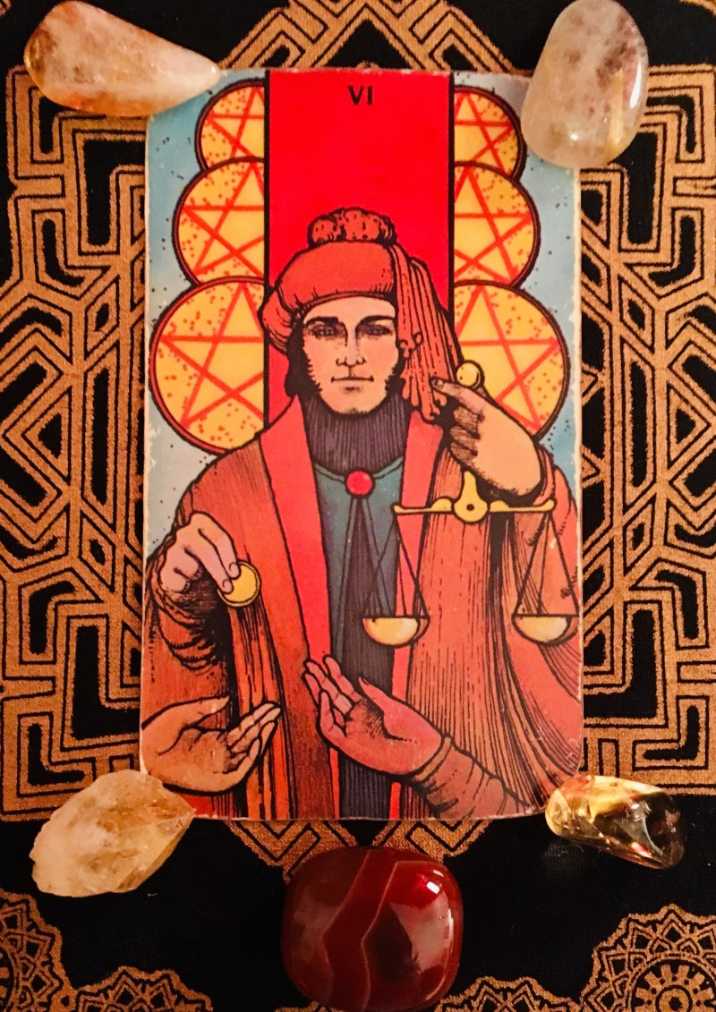 six of coins tarot card