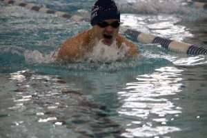 Swimmer gasps for air. Photo by Joardanne Hamilton