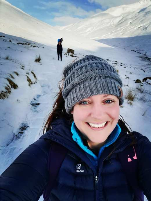girl with snowy backdrop scotland