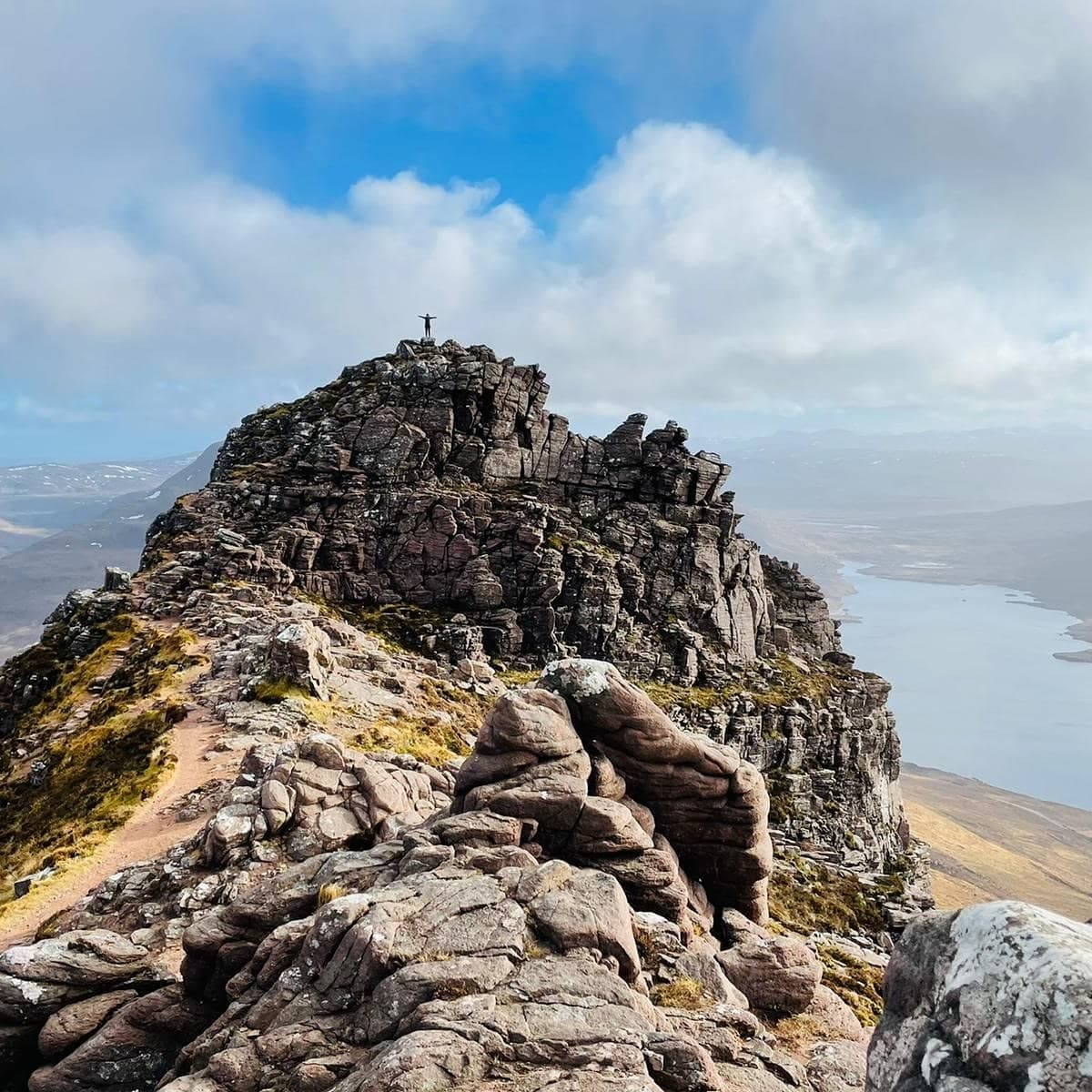 Standing on the East Summit of Stac Pollaidh NC500