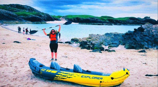Girl with kayak at clachtoll beach