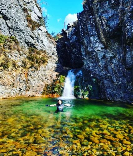 Girl in waterfall pool at Allt Daraich