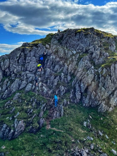 Scrambling up rocks after 7th Munro