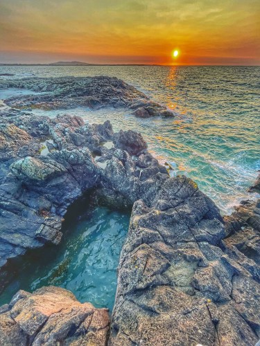 Balephetrish rock arch at sunset