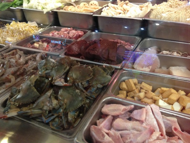 Pick your hot pot ingredients: oxblood pudding, live crabs and chicken wings