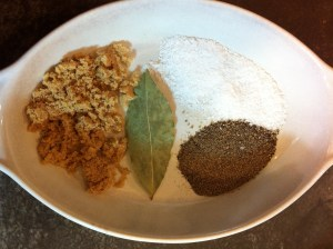 Clockwise from top: kosher Salt; ground Black Pepper; Bay Leaf; Brown Sugar.