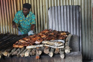 One of the cooks tending to the jerk chicken and pork at Scotchies