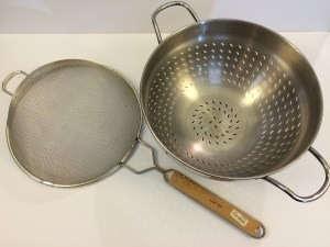 On the left, a strainer; the right, a colander. They do a lot of the same things, but a strainer is used for finer work (i.e. sifting, straining purees, etc.). Don't confuse the two.