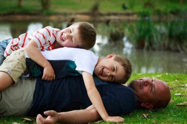 kids-lying-on-dad-and-laughing