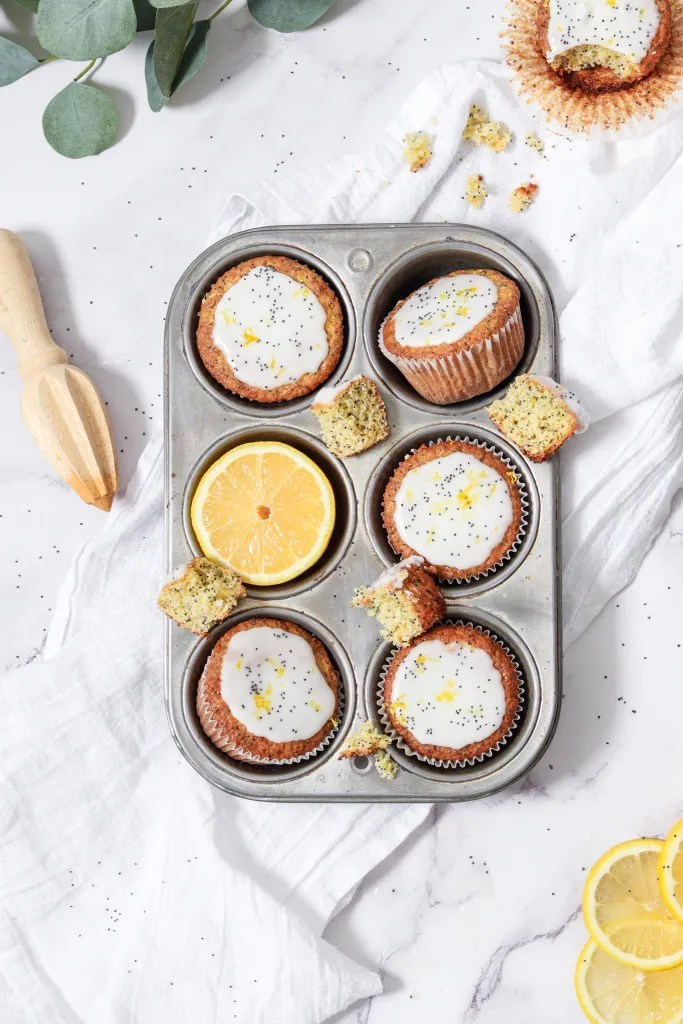 Lemon Poppy Seed Muffins in a muffin tin with food props
