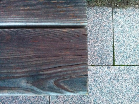 Woodgrain contrasting with the granite slabs
