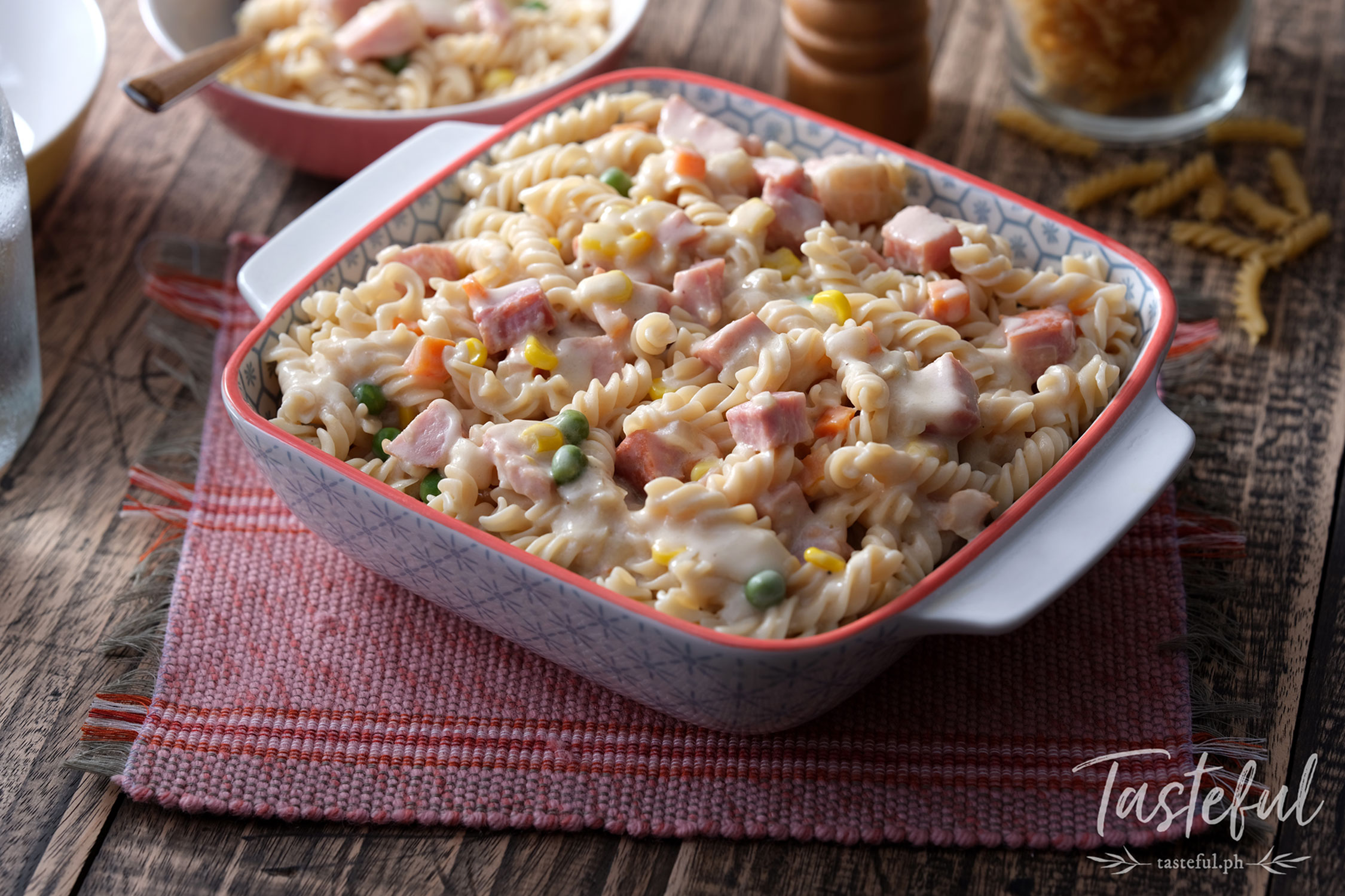 Creamy pasta with vegetables, ham, and cheese