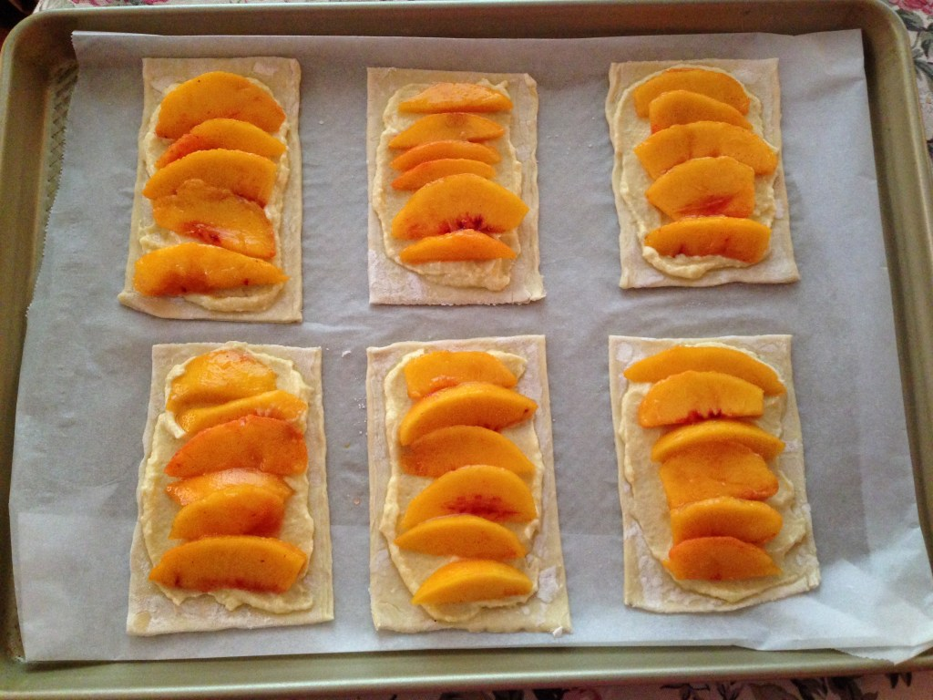 Place sliced peaches on top of the frangipane filling