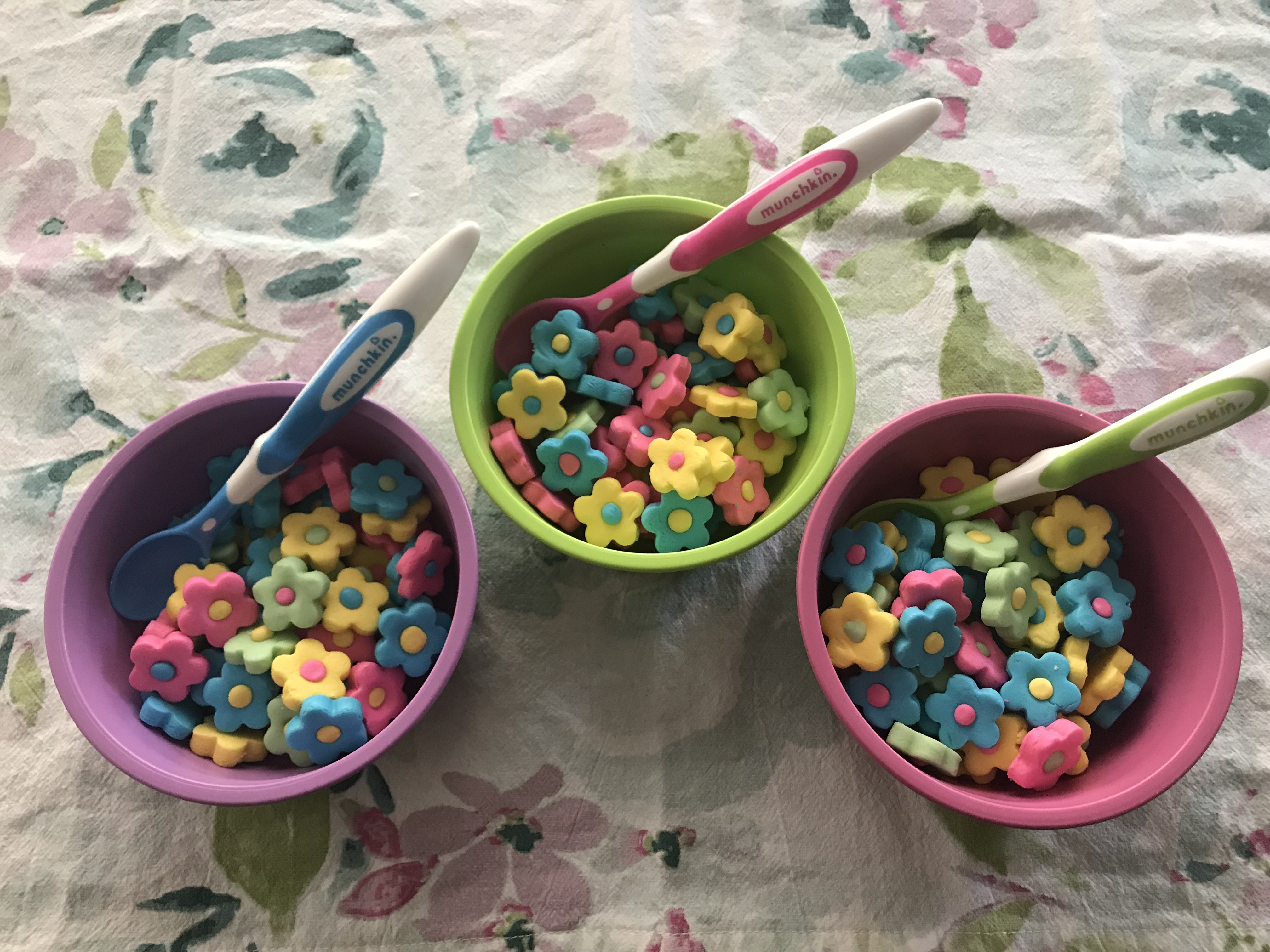 Butter Mints in toddler bowls with toddler spoons