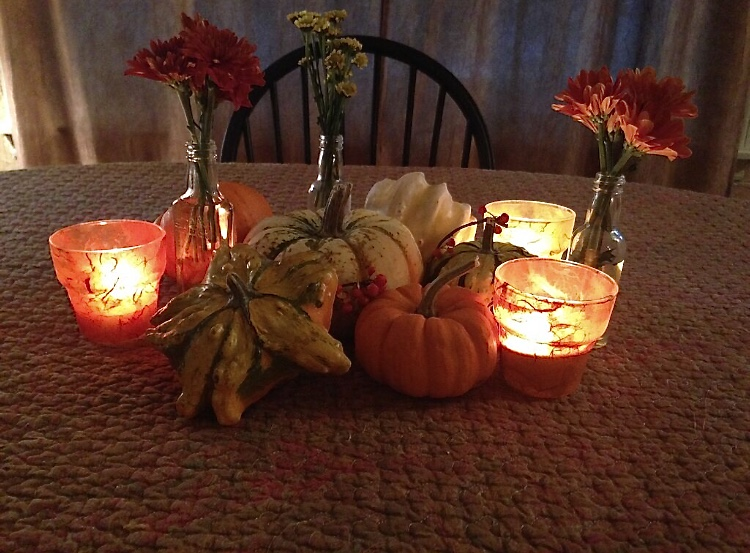 Layered Tissue Paper Votive Holders with pumpkins on table