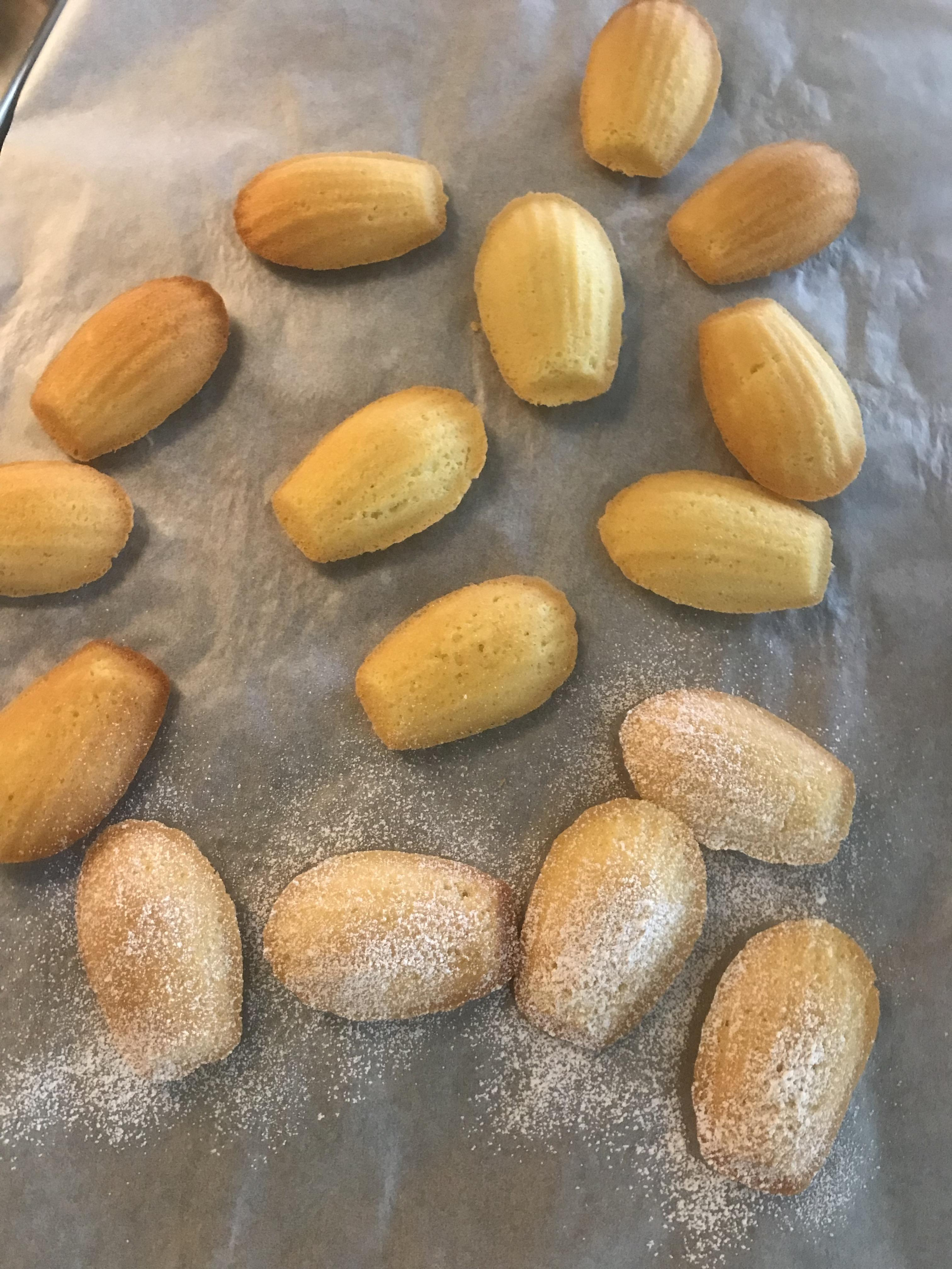 Sprinkle Brown Butter Madeleines with confectioners sugar