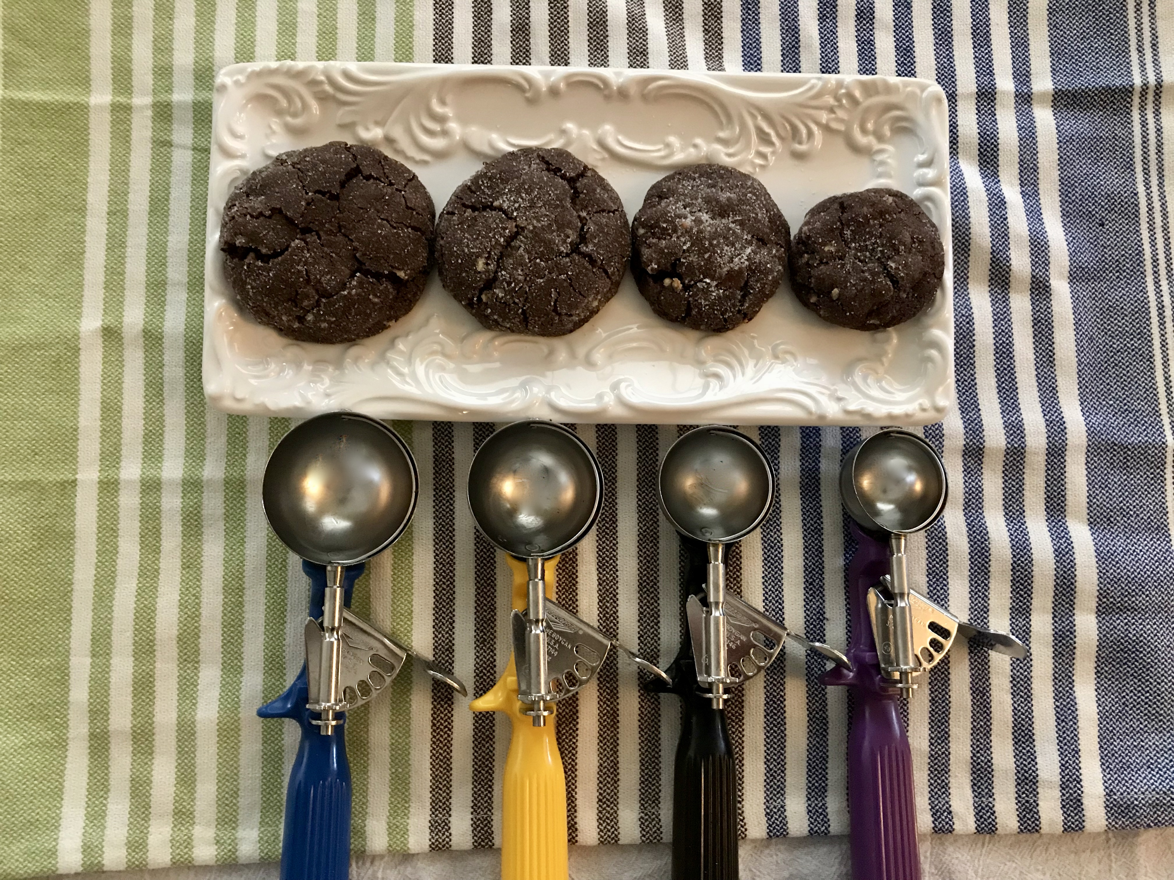 Different dishers with varying sizes of baked cookies