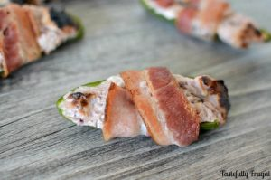 Bacon Wrapped Raspberry Chipotle Jalapeno Poppers: The sweet taste of raspberry is the perfect way to soften the spice of these crunchy jalapeño poppers.