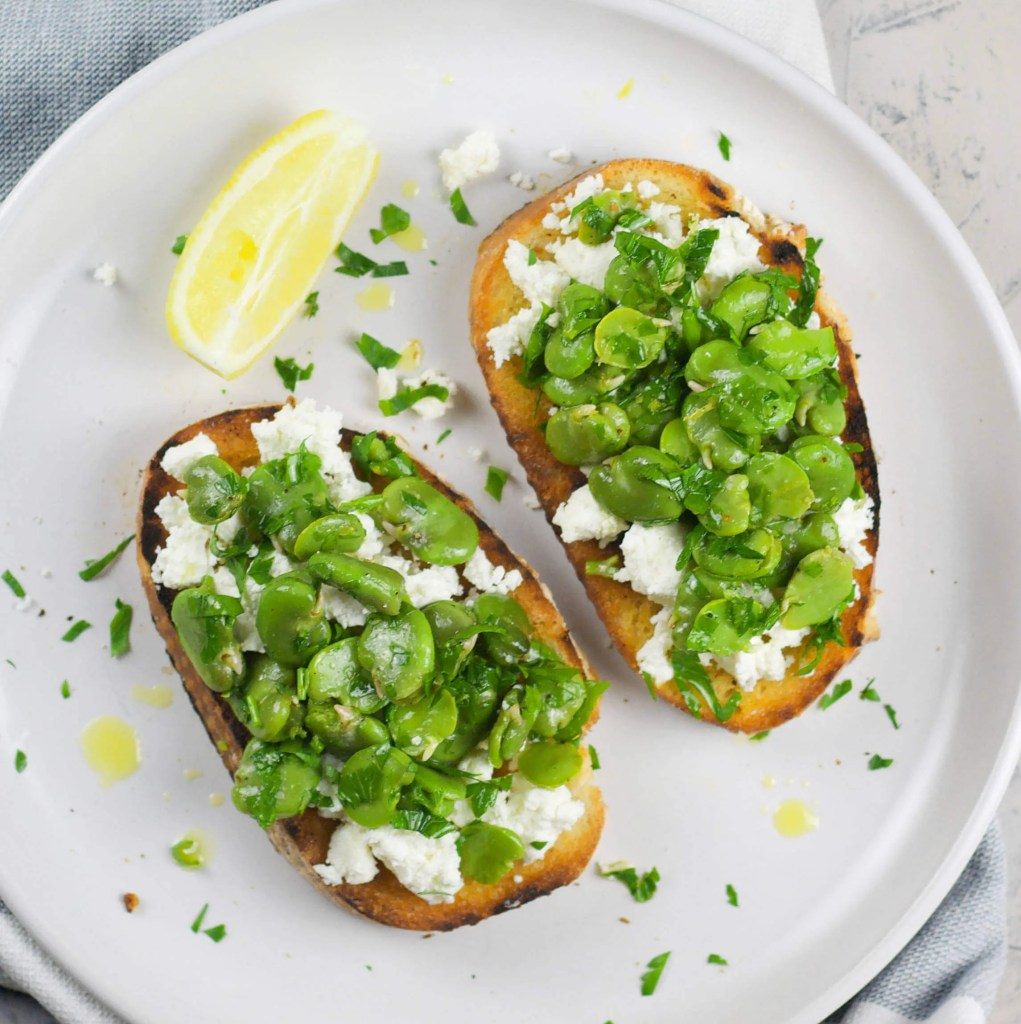 Perfect garlic toast with broad beans and goat cheese.