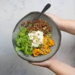 Healthy bowl with red quinoa (sweet potato, poached eggs and lemon dressing) 1