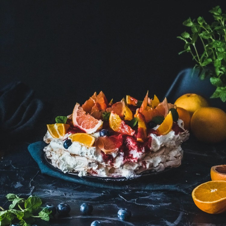 Blood orange Pavlova with blueberries.