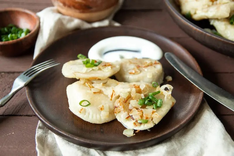 Amazing traditional Polish pierogi filled with duck meat and vegetables. 2