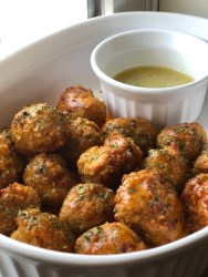 This is a picture of buffalo chicken meatballs. The meatballs are served with a side of ranch and the meal is Whole 30, Paleo, and Keto compliant.
