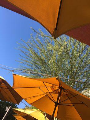 Blue skies & gold umbrellas...