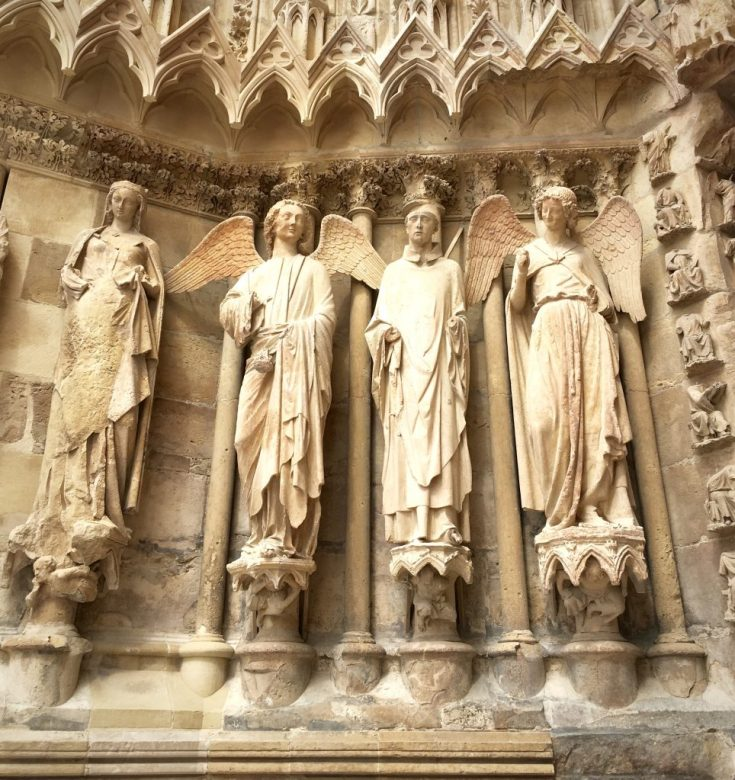 The figures at the entrance to the Notre Dame Cathedral
