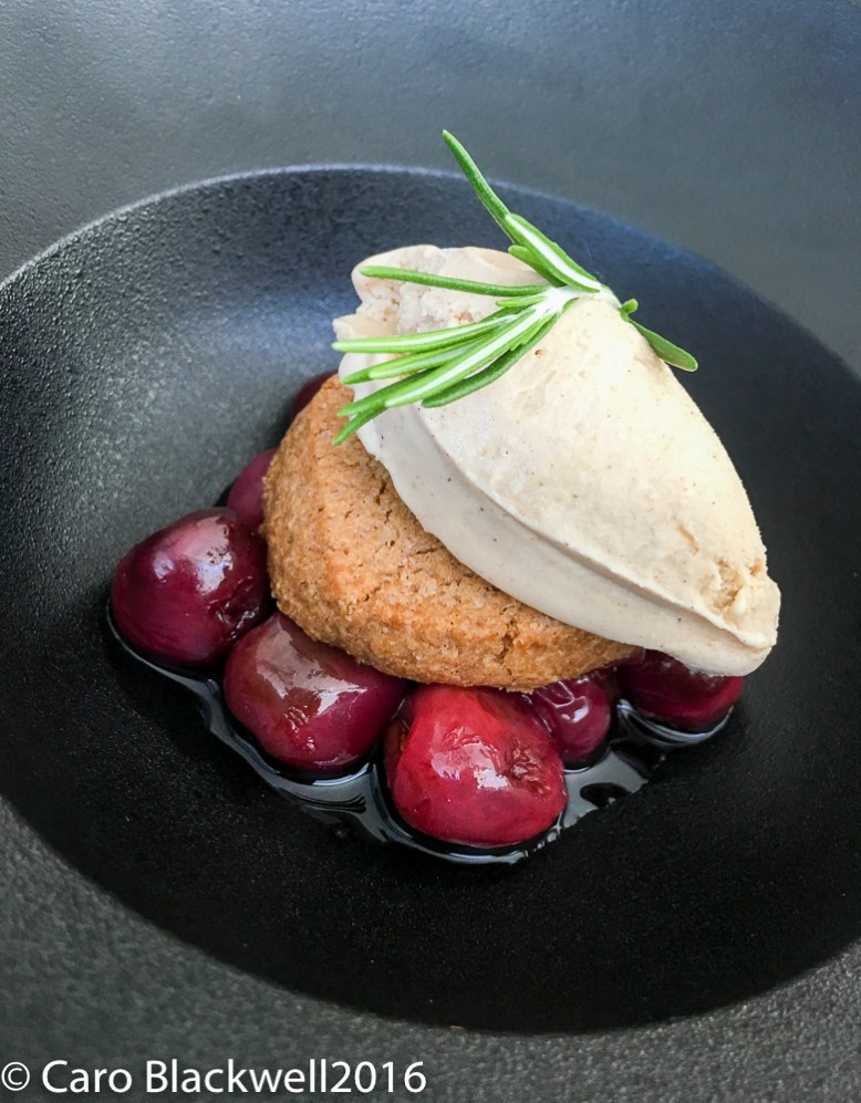poached cherries topped by a homemade speculoos shortbread style cookie and topped with a pain d'epices ice cream