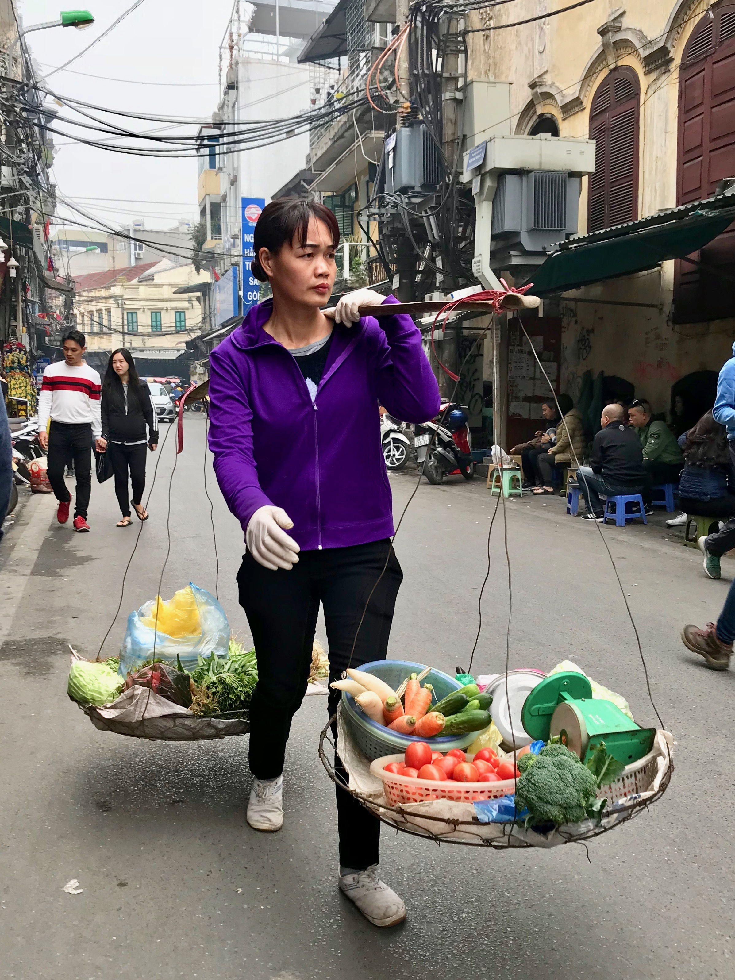 Street Vendor in the Old town of Hanoi