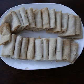 Kisra, individual kisra leaves folded for serving. South Sudanese food. Sudanese food.