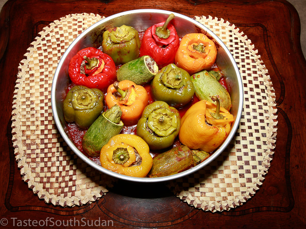 Mahshi, roasted stuffed zucchini and bell peppers, in a bed of tomato sauce. South Sudan cuisine, Mediterranean cuisine, Sudanese food.