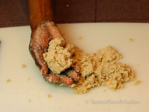 Kneading ground sesame seeds by hand. Taste of South Sudan recipe, Sudanese food, South Sudanese food, African food.